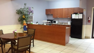 Activity room with kitchenette, TV lounge area